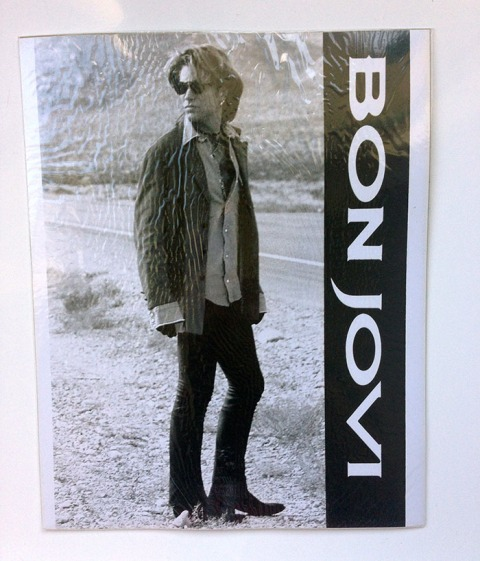 "10 x 8"" Black & White photo of Jon Bon Jovi circa Keep the Faith era with ""Bon Jovi"" down right hand side."