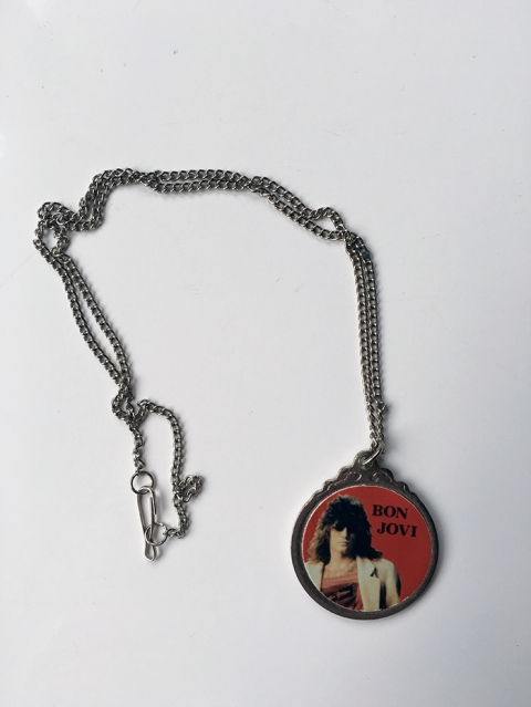 Metal circular pendant with picture of Jon Bon Jovi on silver chain - www.bonjovisale.com